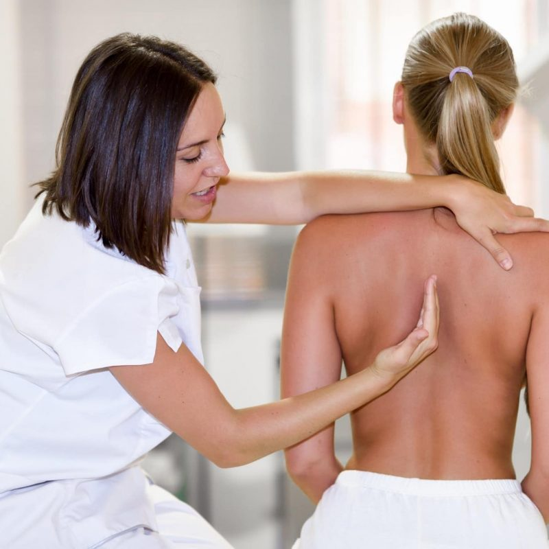Medical check at the shoulder in a physiotherapy center.